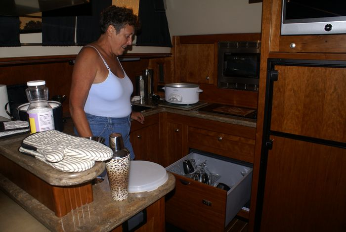 Betty Lou showing off her dishwasher on Lions' Den